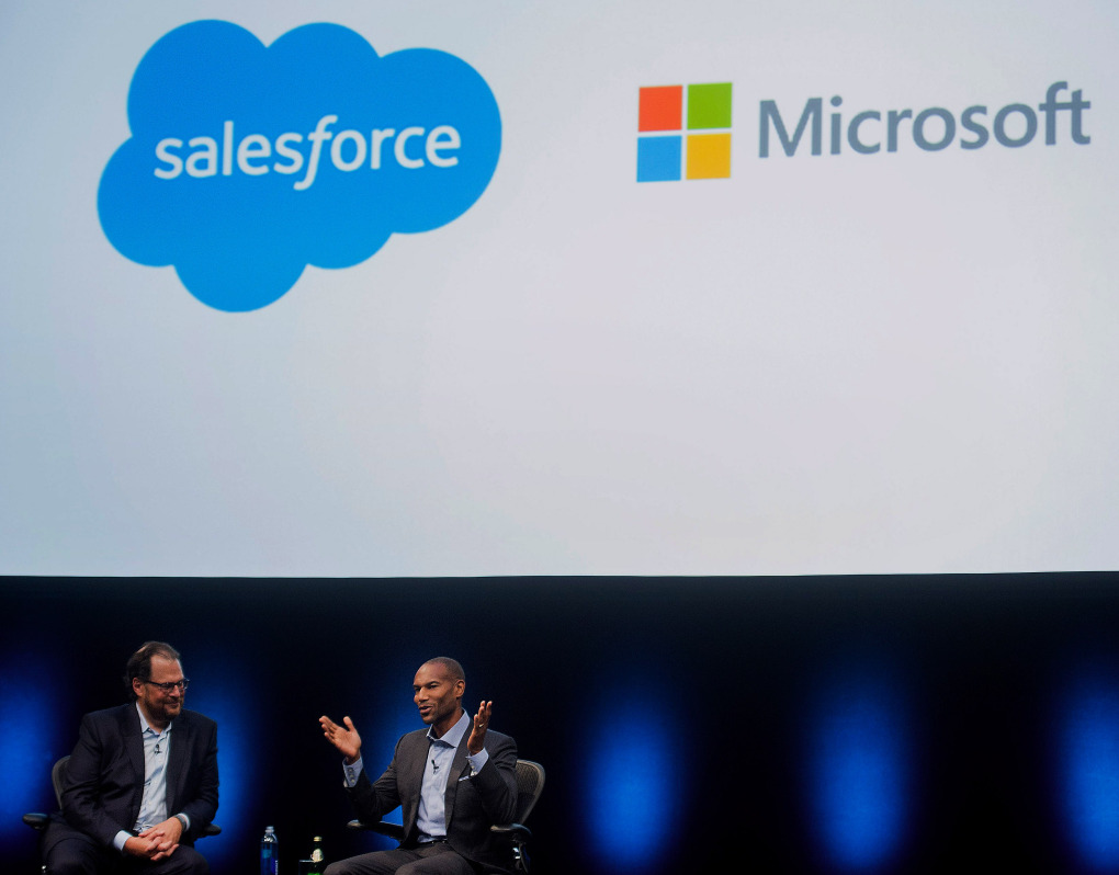 Marc Benioff, chairman and chief executive officer of Salesforce.com Inc., left, speaks with Tony Prophet, vice president of Windows marketing at Microsoft Corp., during the DreamForce Conference in San Francisco, California, U.S., on Monday, Oct. 13, 2014. Salesforce.com Inc. is entering a new business, data analytics and business intelligence, seeking to maintain growth and persuade customers to pour more of their information into its data centers. Photographer: Noah Berger/Bloomberg *** Local Caption *** Marc Benioff; Tony Prophet